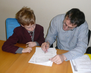 A pupil being tutored in Key Stage 2 Maths by John Cashin